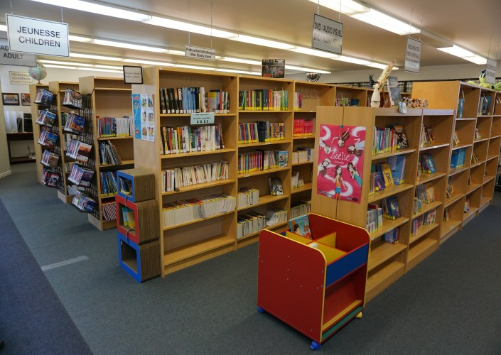 three shelves with books