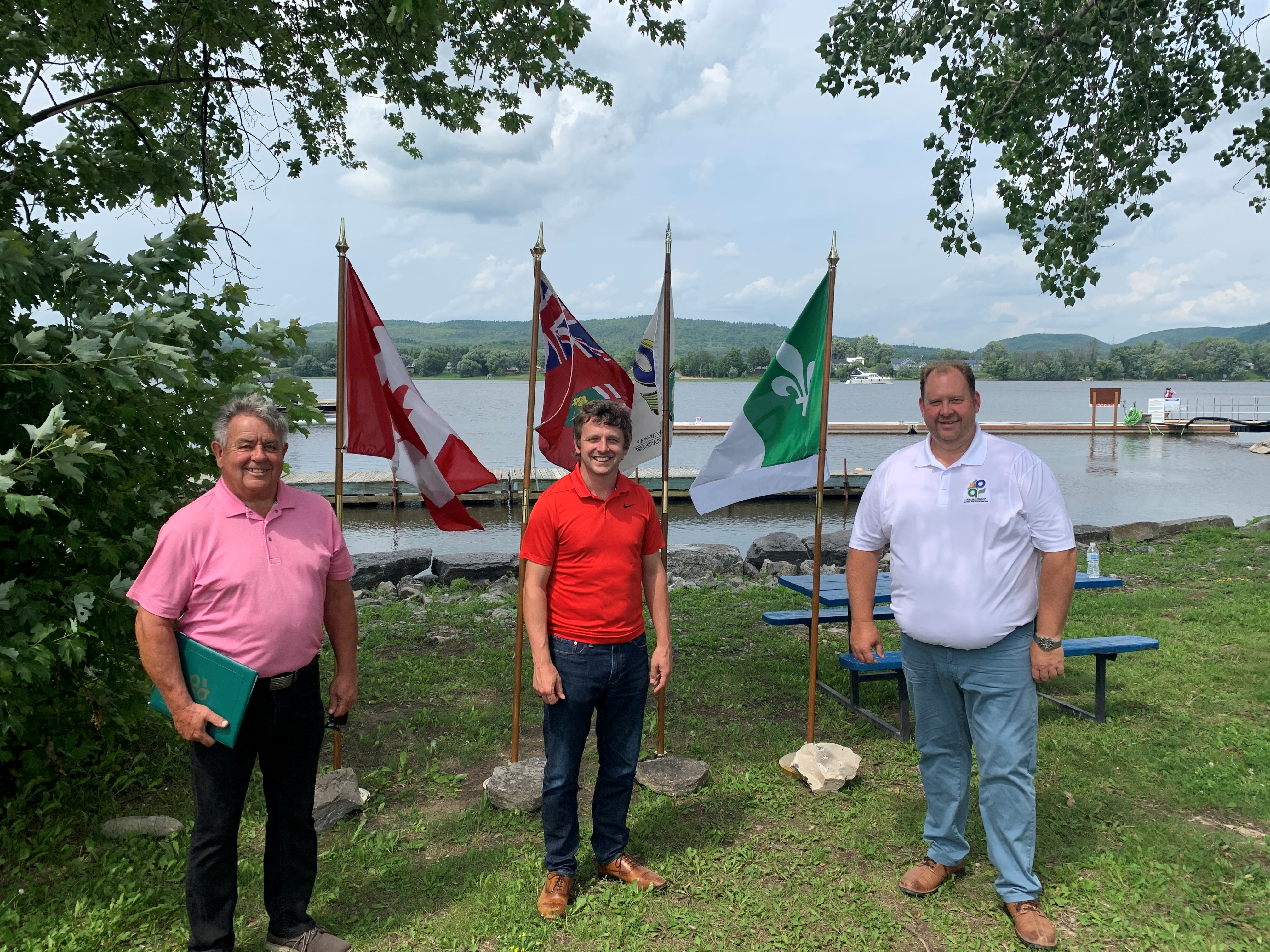 Pictured from left to right: Municipal councillor Yves Laviolette, Liberal MP Francis Drouin, Township of Alfred and Plantagenet Mayor Stephane Sarrazin with the Ottawa River in the background, on an overcast day.